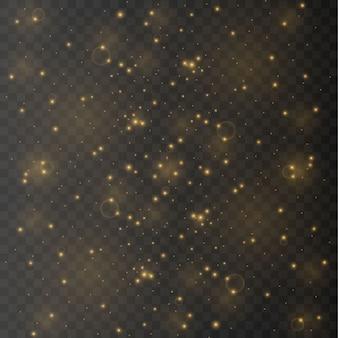 ほこりは黄色です。黄色の火花と金色の星が特別な光で輝いています。透明な背景のベクトルの輝き