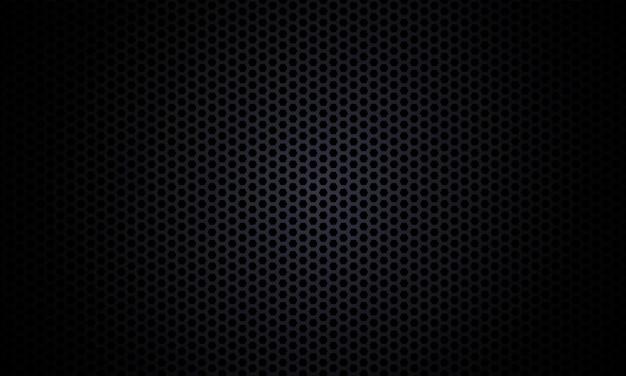 黒の背景。暗い六角形の炭素繊維のテクスチャです。黒いハニカム金属質感鋼背景。