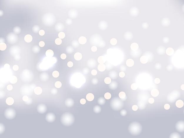 背景の銀のボケ味。キラキラと休日輝く銀のライト。お祝いデフォーカスライト。明るい背景にぼやけた明るい抽象的なボケ味。