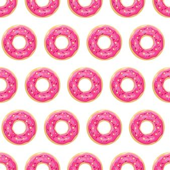 ドーナツのシームレスなパターン。ピンクの艶をかけられたドーナツ。
