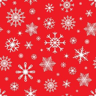 雪のシームレスなクリスマス。赤の背景にスノーフレークパターン。冬