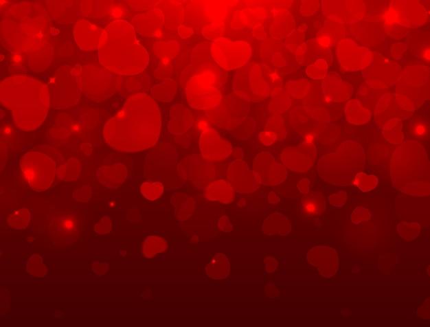 愛とバレンタインの明るい背景に赤いハート、テキスト用のスペース