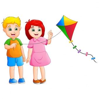 Мультяшный пара детей, играющих воздушных змеев