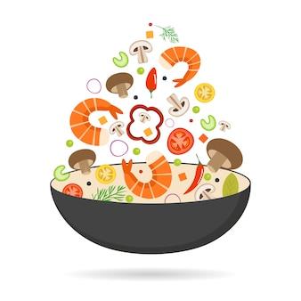 中華鍋、トマト、パプリカ、コショウ、キノコ、エビ。アジア料理。シーフードと野菜を飛んでいます。