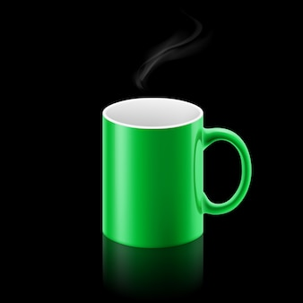 黒の背景に緑のマグカップ