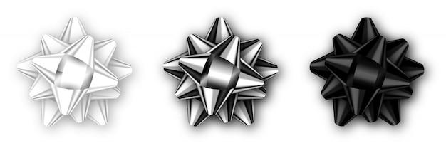 影で現実的な孤立した黒、銀、白の弓のセット。ベクトルテンプレート