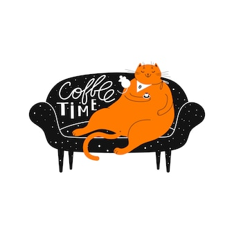 Рыжий улыбающийся кот с чашкой кофе на диване.