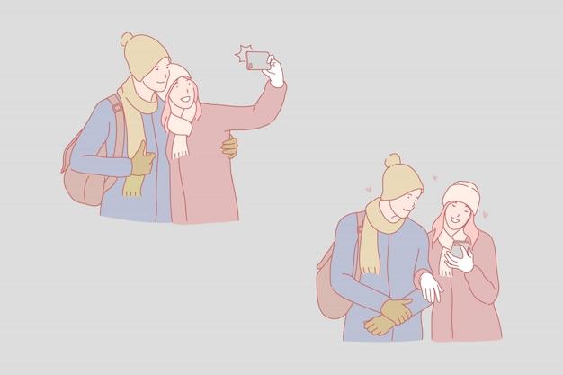 Селфи снаружи, молодая пара, принимая фотографии концепции