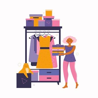 若い女性は服でクローゼットを片付けています。ホームクリーニング。自宅でのお気に入りのアクティビティ。自宅で過ごす時間