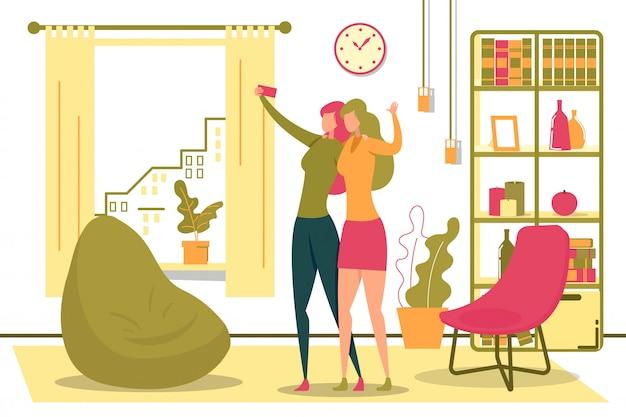Женщины, принимающие селфи с мобильным телефоном в комнате