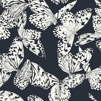 ディープブルーに黒と白の蝶のシームレスパターン