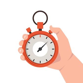 Рука держит красный секундомер