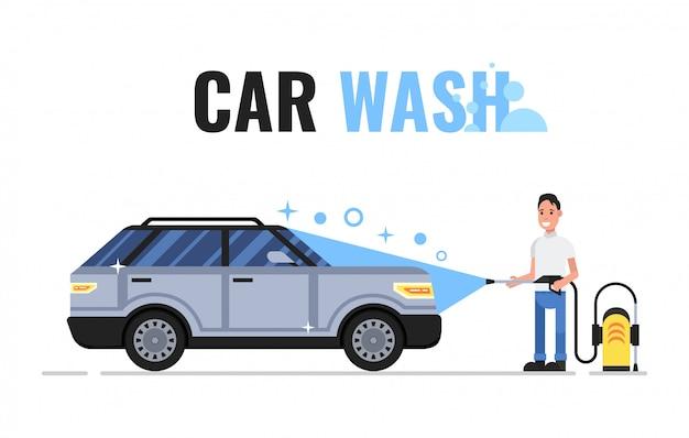 男は石鹸と水で車を洗う