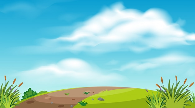 丘の上の道のある風景の背景
