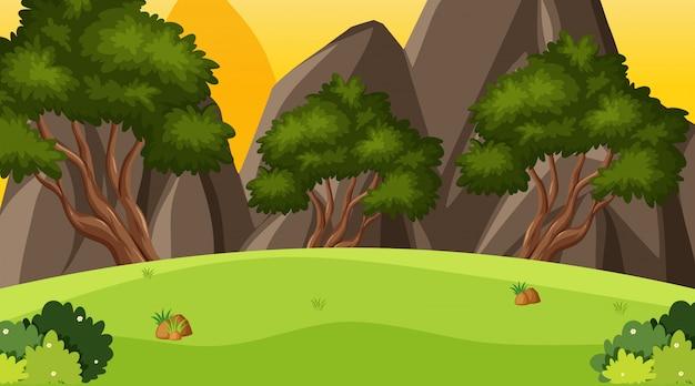 丘の上の緑の草のある風景の背景