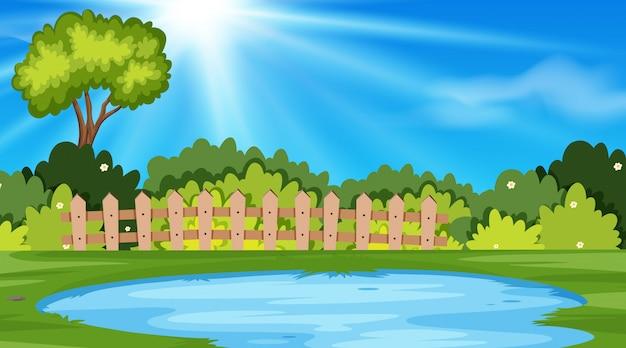 池のある公園の風景の背景