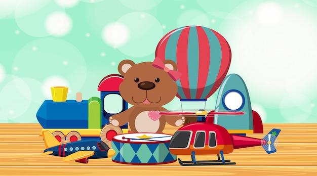Много милых игрушек на деревянном полу