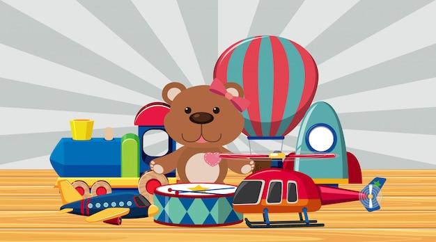 Много игрушек на деревянном полу