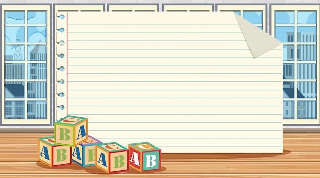 床にアルファベットブロックを持つ紙テンプレート