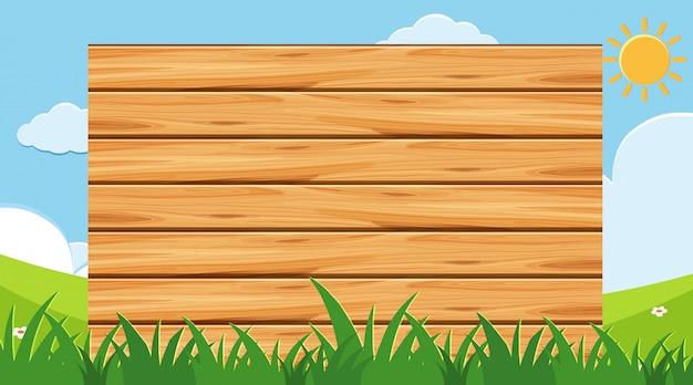 公園の背景を持つ木の板