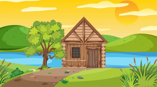 フィールドの木製コテージとのシーン