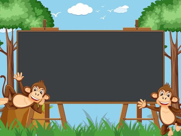 動物園で幸せな猿と黒板テンプレート
