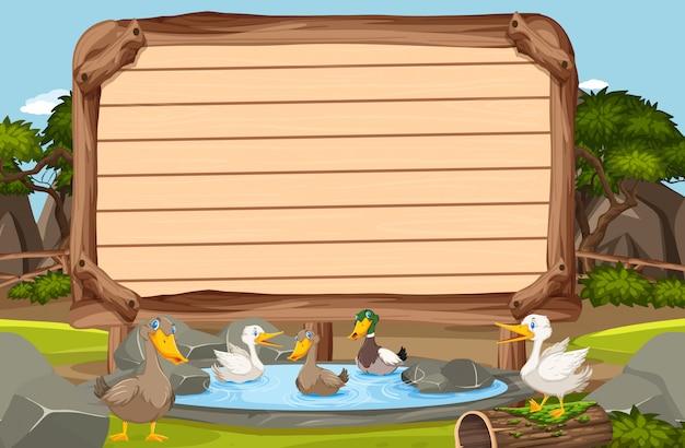 池で泳ぐ多くのアヒルの木製看板テンプレート