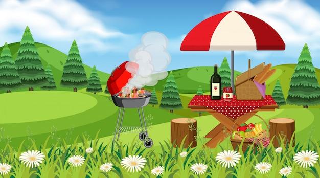公園でのピクニックテーブルとバーベキューグリルのシーン