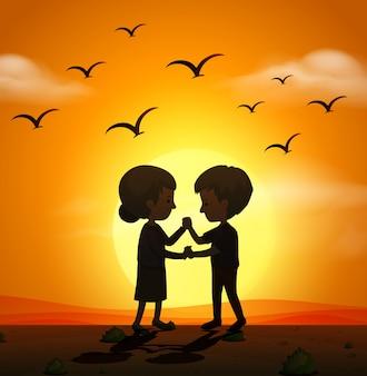Силуэт сцена с любовью пара, держась за руки на закате