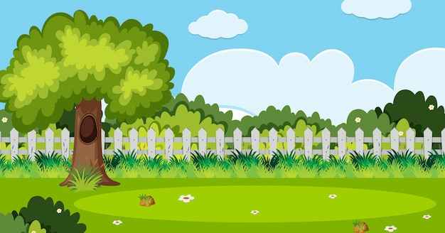 庭の木と白いフェンスの背景のシーン