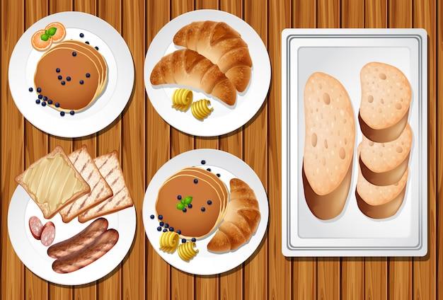 木製テーブルでの朝食セット