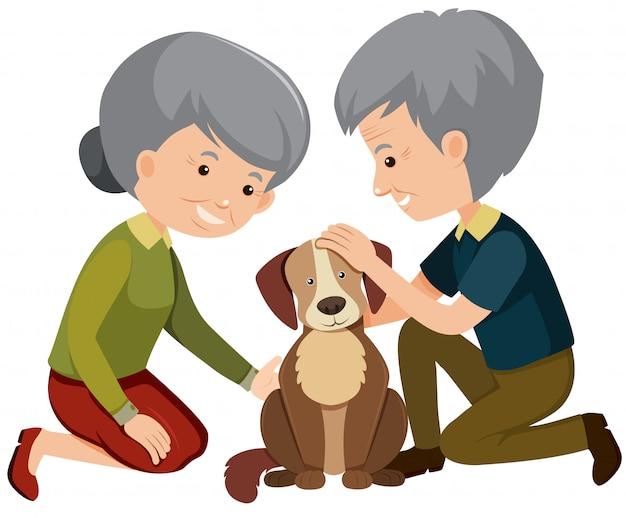 犬を撫でる高齢者のカップル