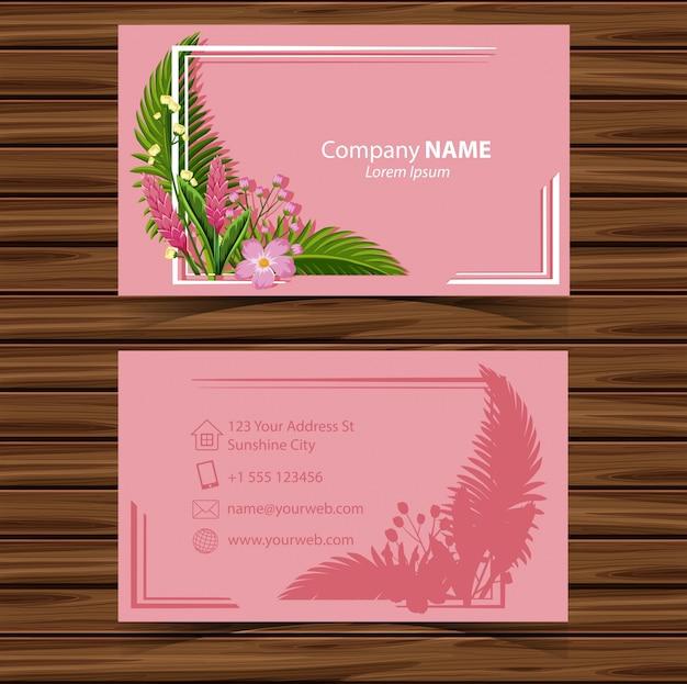 Шаблон визитной карточки с цветами на розовом фоне