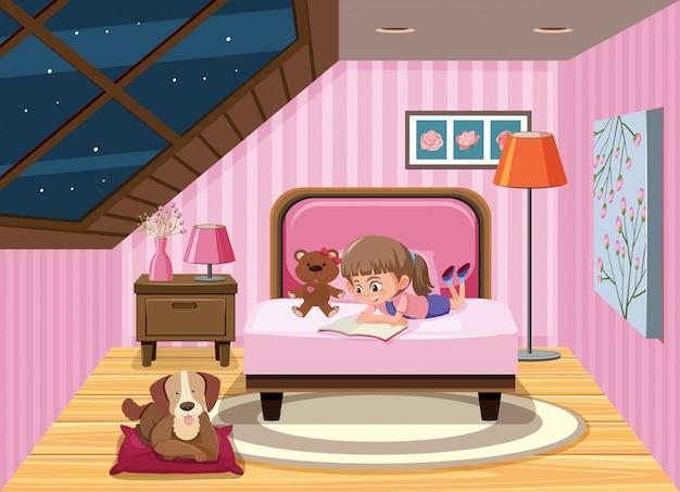 ベッドの女の子の読書