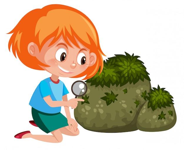 虫眼鏡を持つ女の子が自然を探索