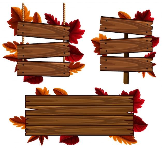 Деревянные знаки с листьями в фоновом режиме