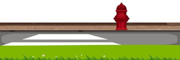 道路と緑の草の風景の背景