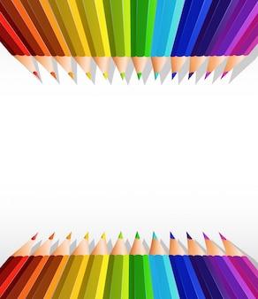 Пустой бумажный шаблон с цветными карандашами сверху и снизу