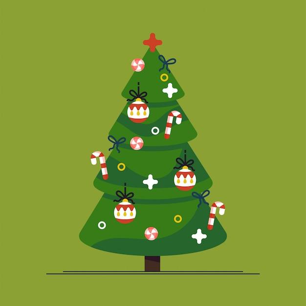 Рождественская елка и праздник. елка украшена звездой, шариками и гирляндами.