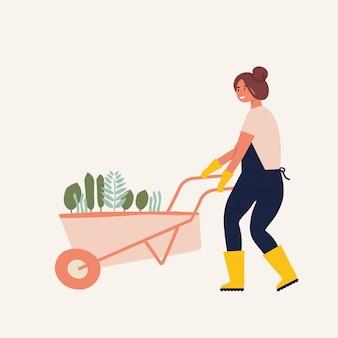 Плоская иллюстрация характера садовника. молодая женщина, держащая тачку земли с растениями.