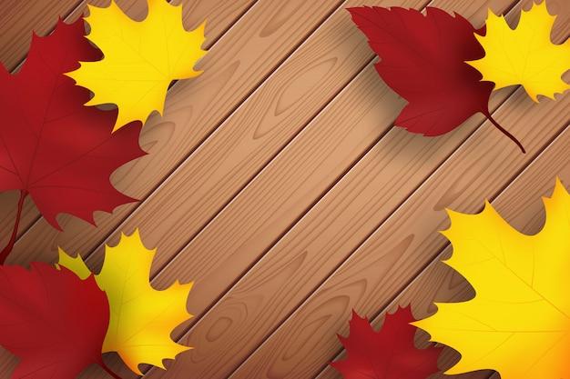 秋の背景。木製の板と落ち葉