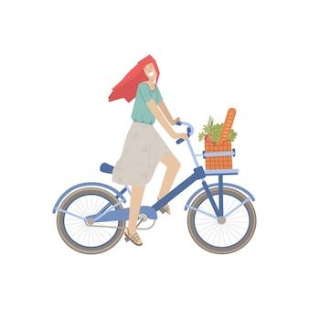 Милая девушка ездить на городском велосипеде с продуктовой корзиной, полной хлеба, зеленью, едой, овощами. усмехаясь счастливая девушка на велосипеде, иллюстрация, ехать от продовольственного магазина, делая деятельность при спорта лета.