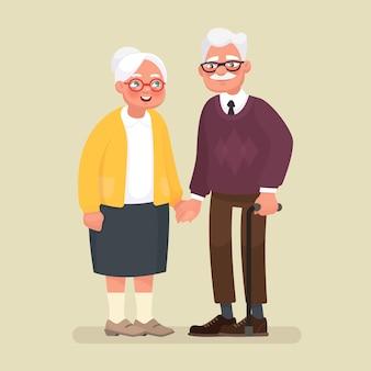 手を繋いでいる老夫婦。