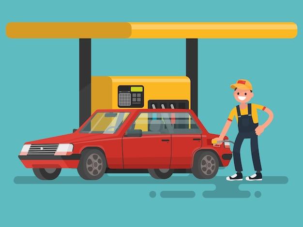 ガソリンスタンド。作業員がガソリンを車に充填します。