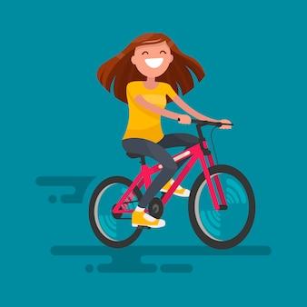 自転車の図に乗って幸せな女の子