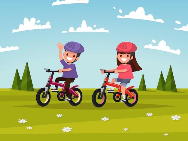 Езда на велосипеде. мальчик и девочка катаются на велосипедах по лугу. иллюстрация