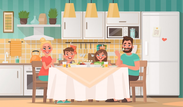 キッチンで食べて幸せな家族。父、母、息子、娘が自宅のテーブルで朝食をとる