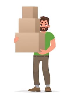 男は白い背景の上のボックスを保持しています。