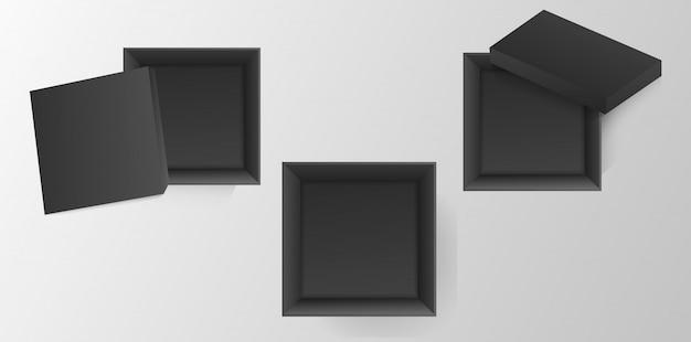 Вид сверху черные картонные коробки.