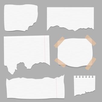 破れた紙、破れたページの破片、スクラップブックのメモ用紙。
